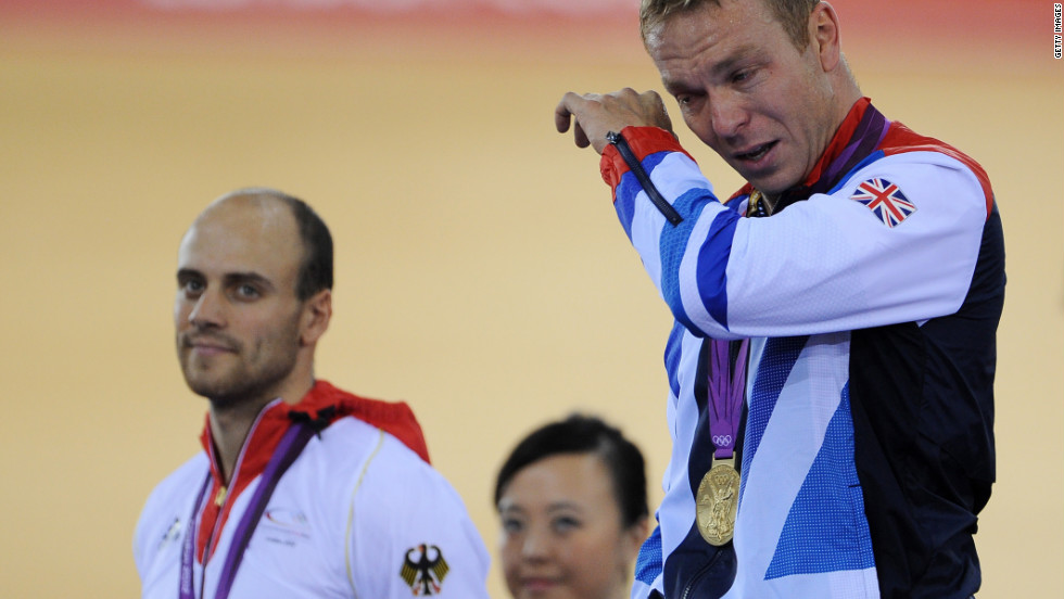 Gold medalist Sir Chris Hoy of Great Britain, right, tears up alongside silver medalist Maximilian Levy during the medal ceremony for the men's keirin track cycling final.