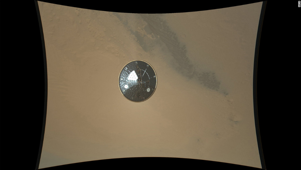 This color full-resolution image showing the heat shield of NASA's Curiosity rover was obtained during descent to the surface of Mars on August 13, 2012. The image was obtained by the Mars Descent Imager instrument known as MARDI and shows the 15-foot diameter heat shield when it was about 50 feet from the spacecraft.