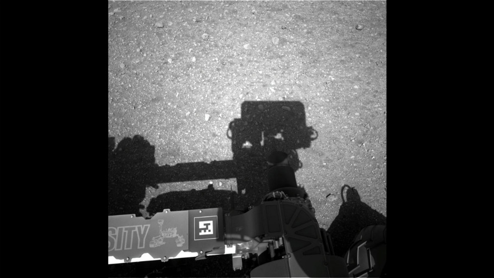 This first image taken by the Navigation cameras on Curiosity shows the rover's shadow on the surface of Mars.