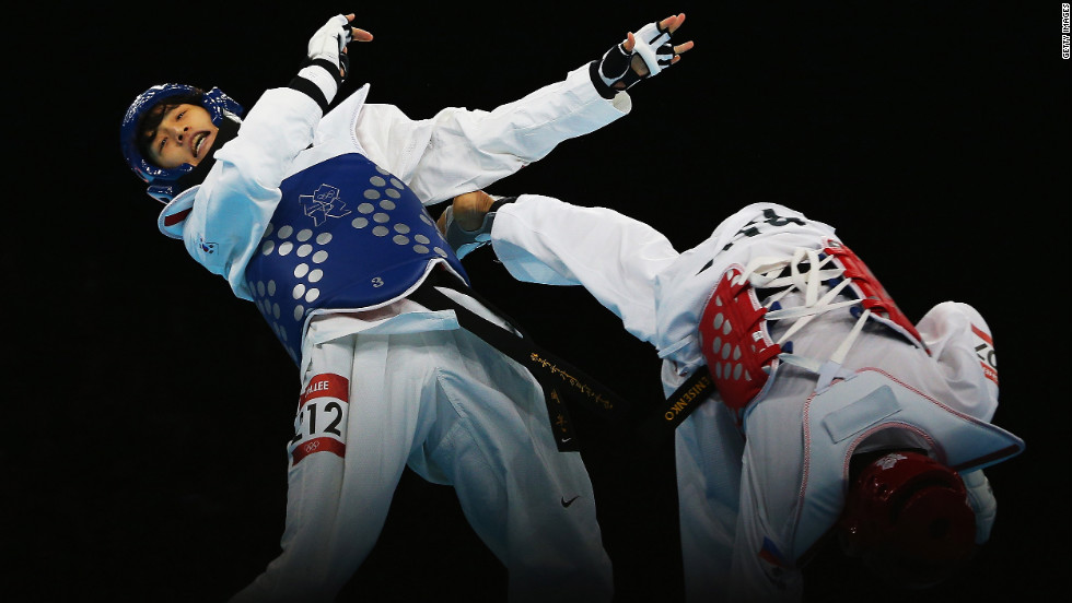 Lee Dae-Hoon of South Korea competes against Alexey Denisenko of Russia during the men's 58-kilogram semifinal taekwondo match.