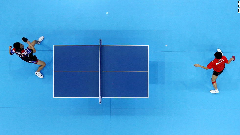 Jike Zhang of China, right, competes against Joo Se-Hyuk of South Korea.