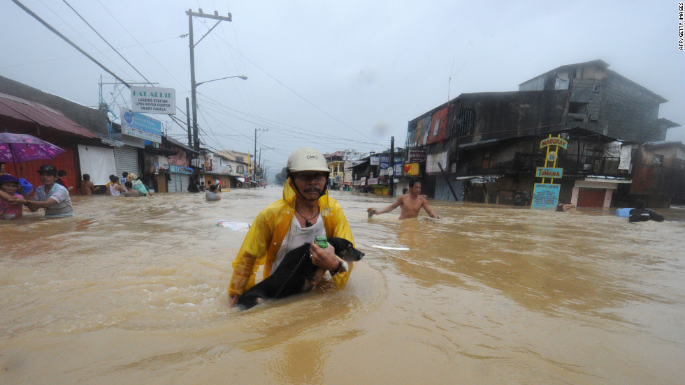 Residents are evacuated from their flooded homes in the village of Tumana, Marikina town, in suburban Manila.