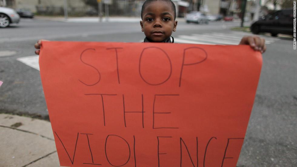 Donte Jones, 5, shares a message written on a handmade sign.