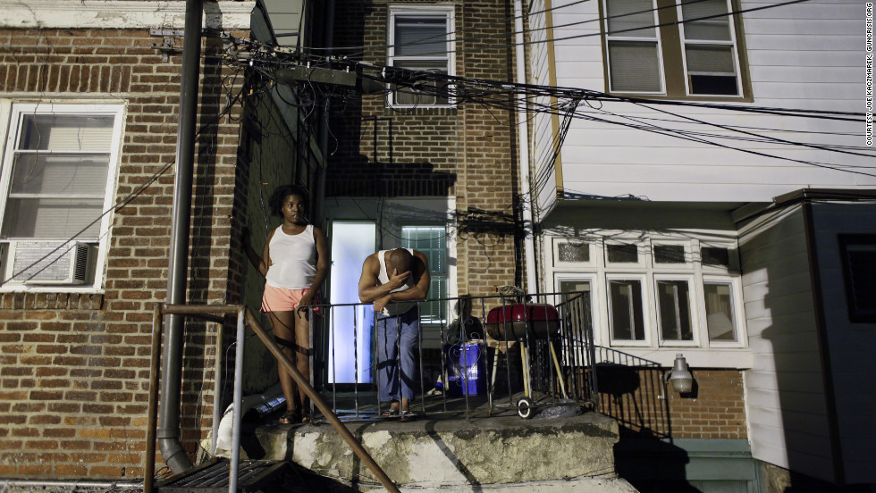 Kaczmarek aims to capture the neighborhood tension surrounding Philadelphia crime scenes, where residents cope with frequent danger from deadly gun violence.