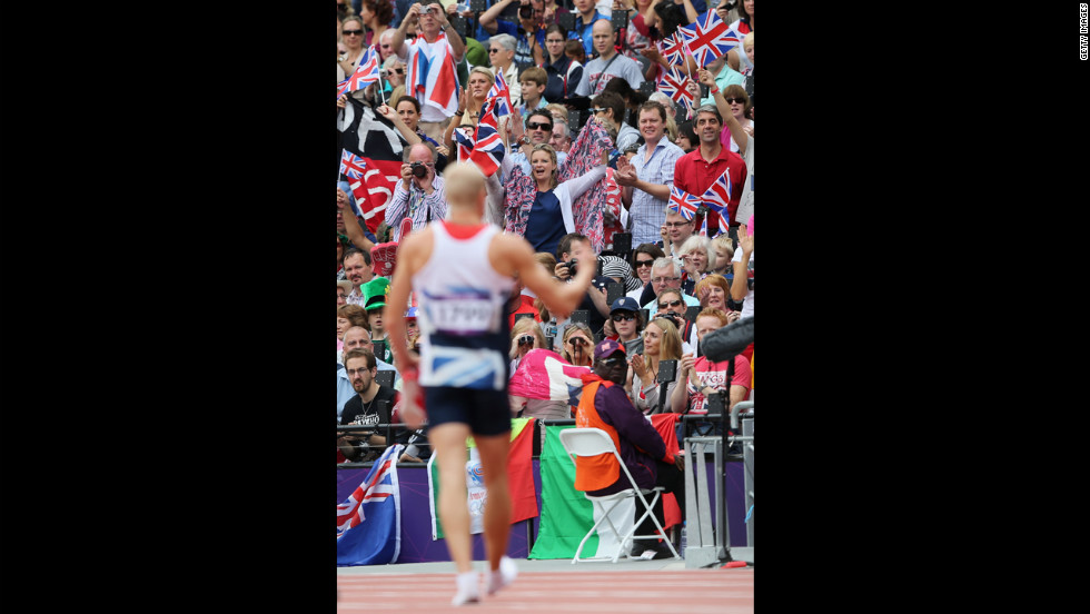 Spectators cheer Daniel Awde of Great Britain after the men's decathlon 100-meter heats.