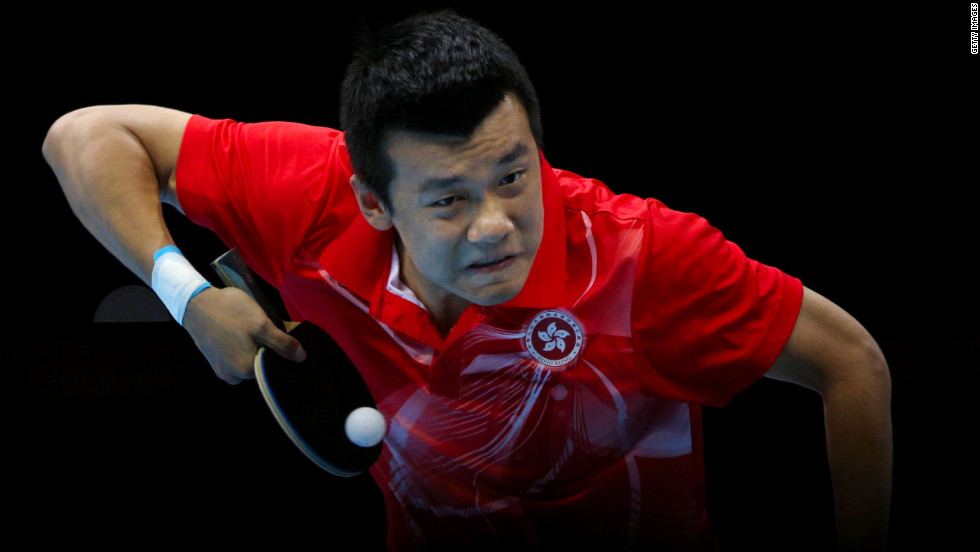 Peng Tang of Hong Kong competes in the men's team table-tennis bronze medal match.