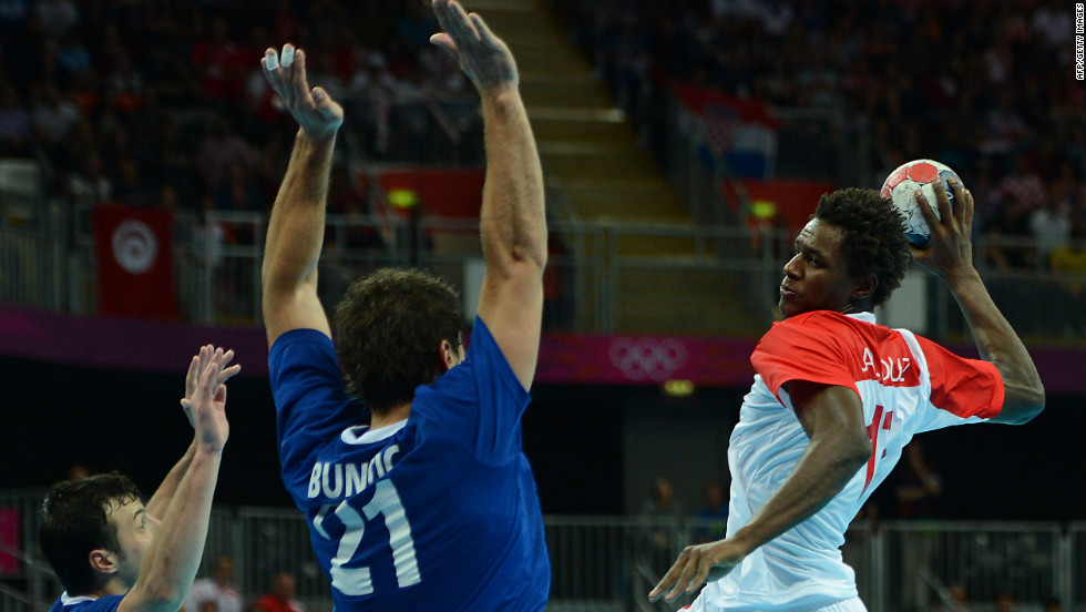 Tunisia's left back Wael Jallouz, right, prepares to shoot during the men's quarterfinal handball match between Croatia and Tunisia.