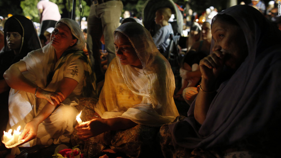 Mourners continue to hold vigils such as the one Tuesday at the Oak Creek Community Center after the carnage left the local Sikh community reeling.