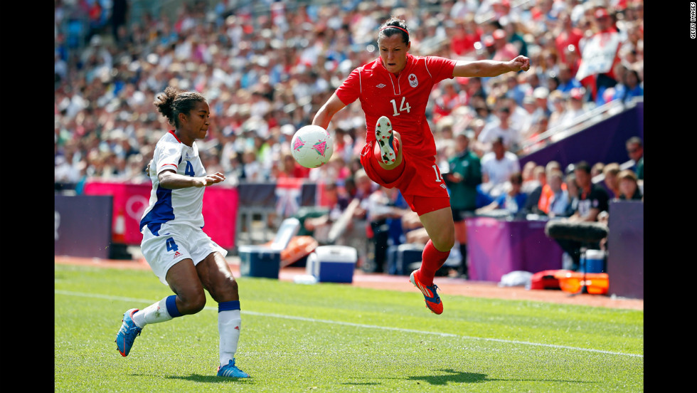 Canada's Melissa Tancredi, right, handles the ball against France's Laura Georges during the women's football bronze medal match.