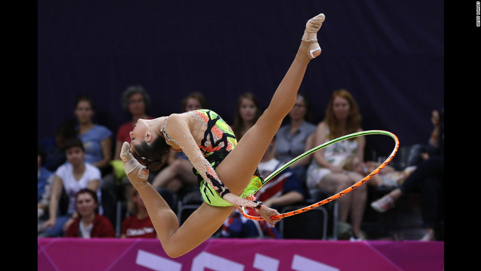 Spain's Carolina Rodriguez performs her hoop routine during the individual all-around qualifications of the rhythmic gymnastics.
