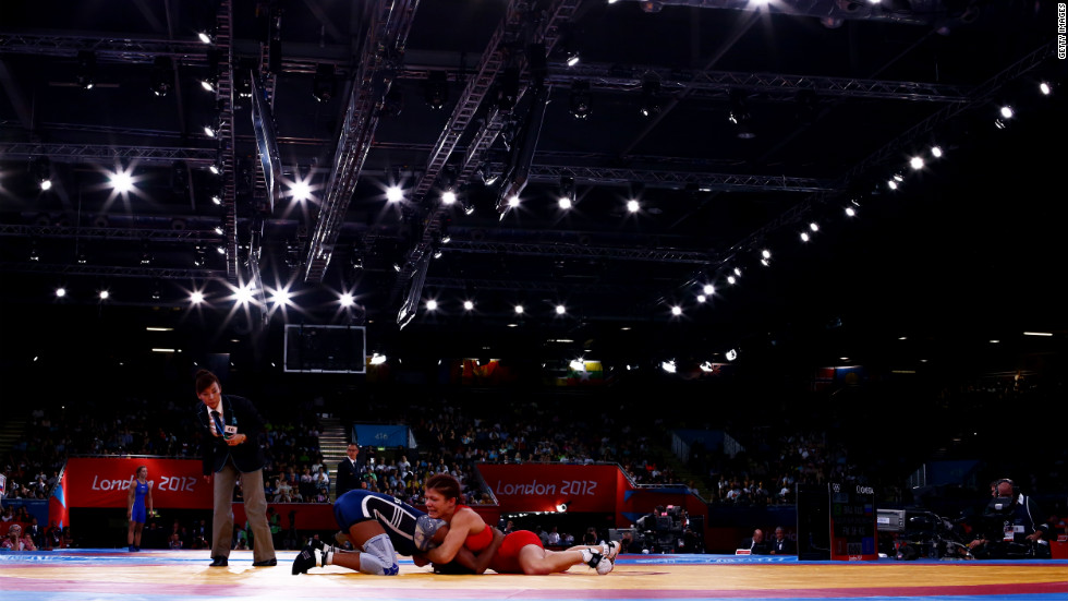 Great Britain's Olga Butkevych, right, and Ecuador's Lissette Alexandra Antes Castillo compete in the women's freestyle 55-kilogram wrestling.