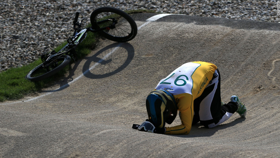Australian rider Khalen Young lies on the ground after crashing during the men's BMX cycling quarterfinals.