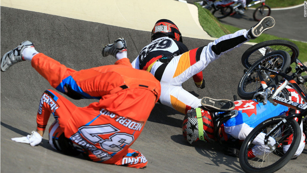 Dutch rider Jelle Van Gorkom, from left, German Maik Baier and Canadian Tory Nyhaug crash during the men's BMX cycling quarterfinals.