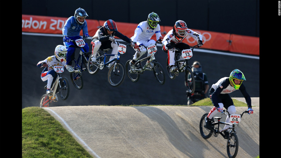 Nicholas Long of the United States, right, leads the field during the men's BMX cycling quarterfinals.