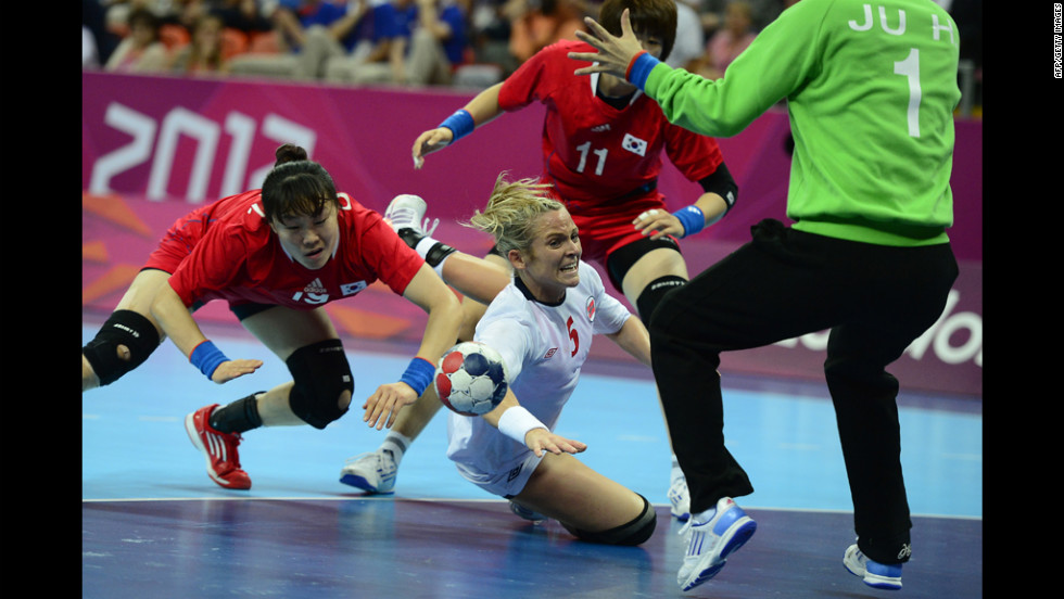 Norway left back Ida Alstad, center, vies with South Korea right back Choi Im-Jeong, left, during the women's semifinal handball match.