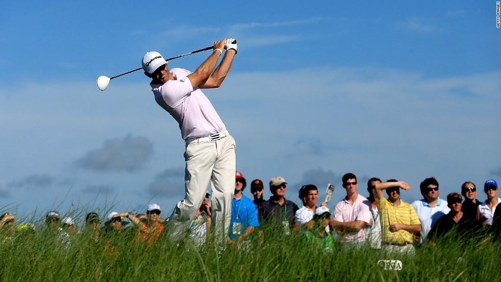 U.S. player Dustin Johnson hits off the 15th tee during the first round of the 94th PGA Championship on Thursday.