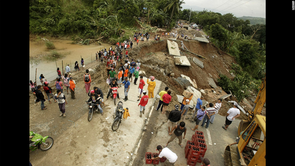 A road was wiped out by flash flooding in Antipolo City, east of Manila.
