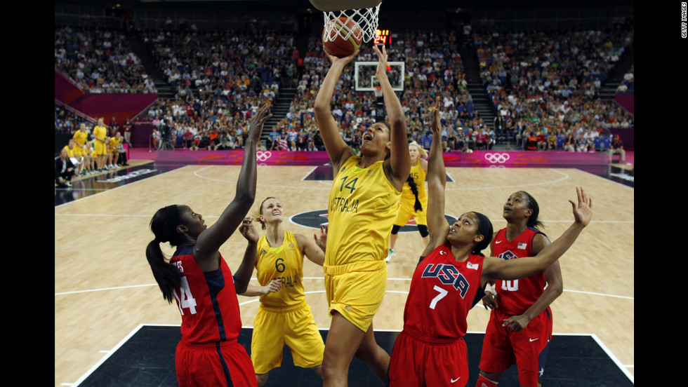 Australia's Liz Cambage, center, shoots over Maya Moore, right, and Tina Charles of the USA.
