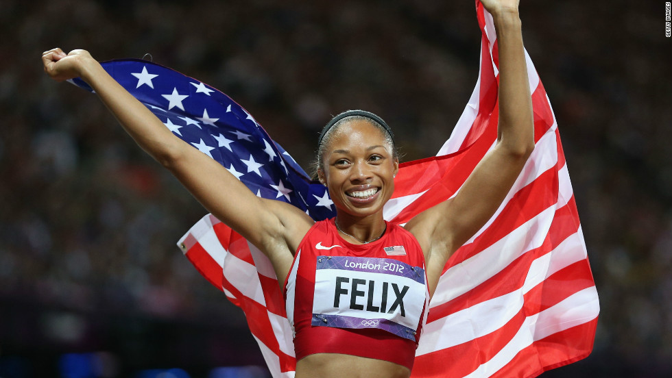 U.S. athlete Allyson Felix celebrates after winning gold in the women's 200m final on Day 12 of the London Games at the Olympic Stadium.