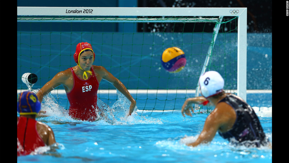 Maggie Steffens of the United States shoots and scores a goal against Spain in the women's water polo match Thursday.