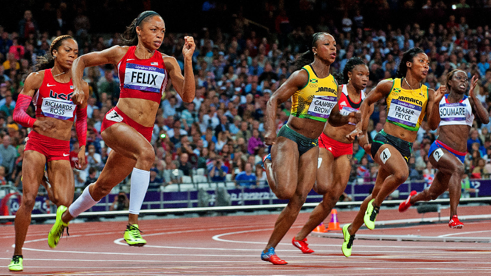 Allyson Felix defeats a truly world-class field to take women's 200m gold. Shelly-Ann Fraser-Pryce of Jamaica, the 100m champion, was a close second with American Carmelita Jeter third.