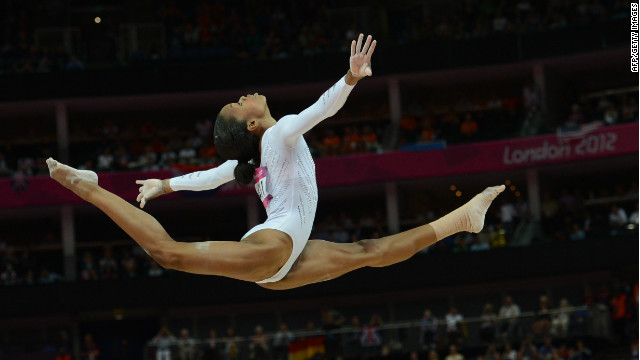 US gymnast Gabrielle Douglas performs during the women's beam final of the artistic gymnastics event of the London Olympic Games on August 7, 2012, at the 02 North Greenwich Arena in London. (Photo credit: EMMANUEL DUNAND/AFP/GettyImages)
