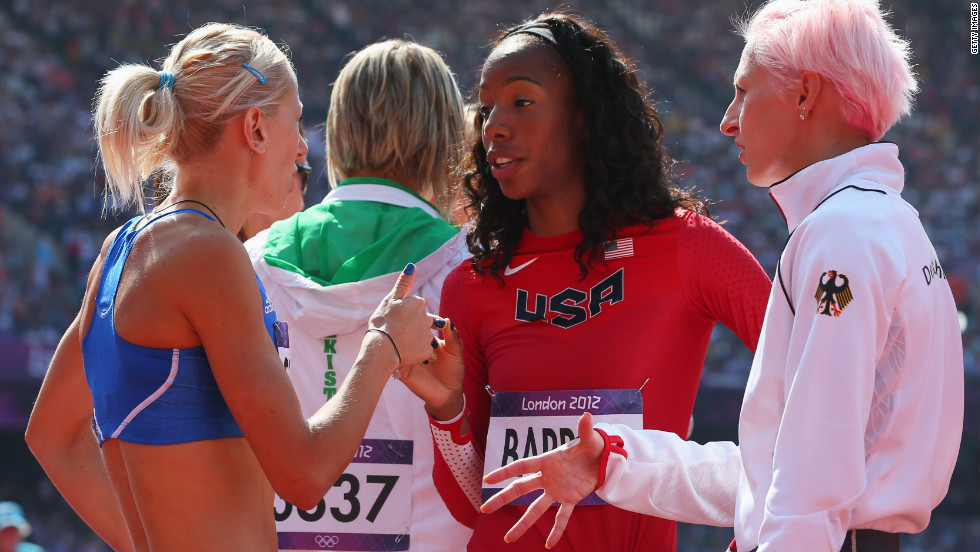 From left, Adonia Steryiou of Greece, Brigetta Barrett of the United States and Ariane Friedrich of Germany converse during the women's high jump qualification.