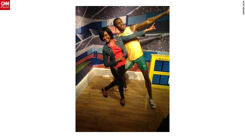 Ehimhen Okoh is on vacation in London and had her boyfriend shoot this picture of her at Madame Tussauds wax museum in front of Usain Bolt's new statue.<br />