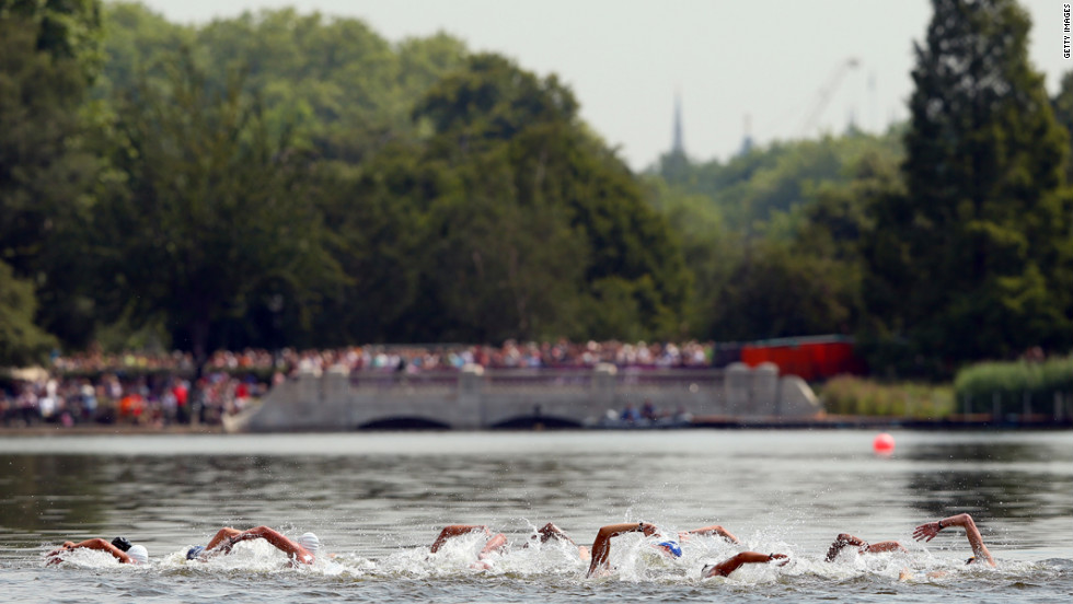 Swimmers compete in the men's marathon 10-kilometer swim at Hyde Park in London.