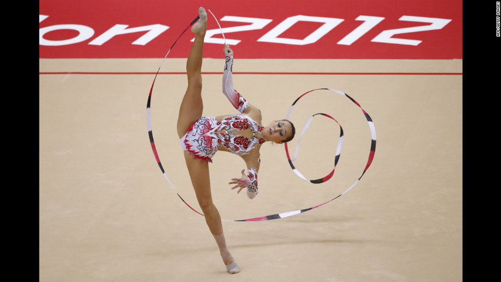 Bulgaria's Silviya Miteva performs her ribbon program during the individual all-around qualifications of the rhythmic gymnastics event.