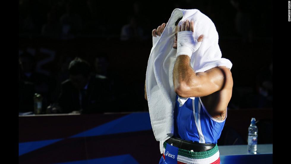 Italy's Vincenzo Mangiacapre leaves the ring after his loss to Cuba's Roniel Iglesias Sotolongo in the men's light welterweight (64-kilogram) boxing semifinals.