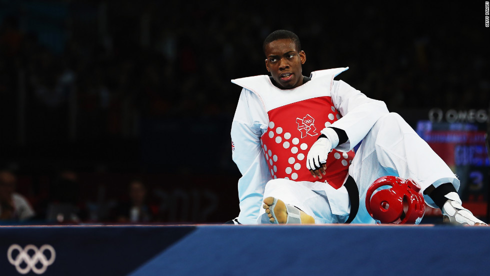 Great Britain's Lutalo Muhammad appears dejected after losing to Nicolas Garcia Hemme of Spain during the men's under 80-kilogram taekwondo quarterfinal.