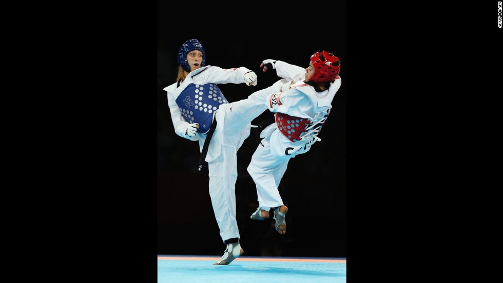 Canada's Karine Sergerie spars with Slovenia's Franka Anic during the women's under 67-kilogram taekwondo quarterfinal.