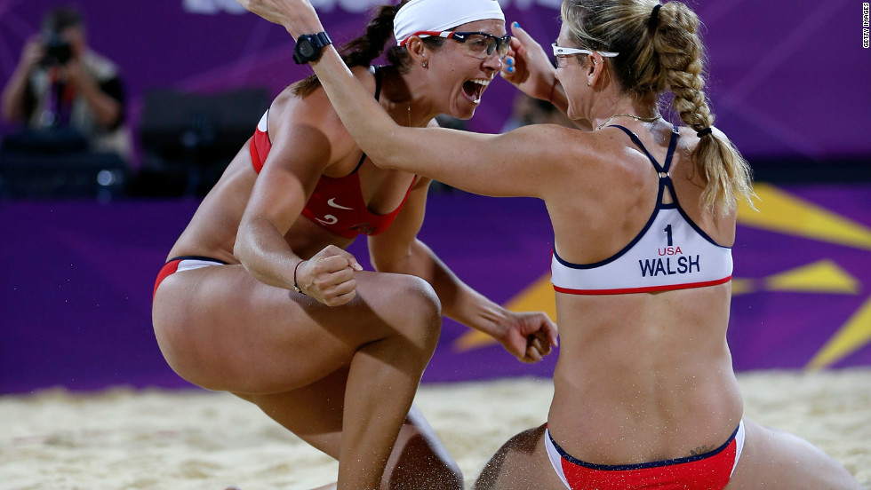 Kerri Walsh Jennings and Misty May-Treanor of the United States celebrate winning their third consequtive gold medal in the women's Beach Volleyball Gold medal match at the Horse Guards Parade during the 2012 Games.