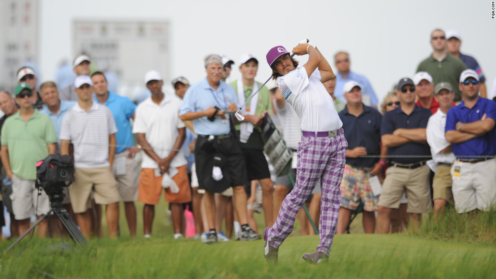 Rickie Fowler punches a ball on the 17th hole on Friday.