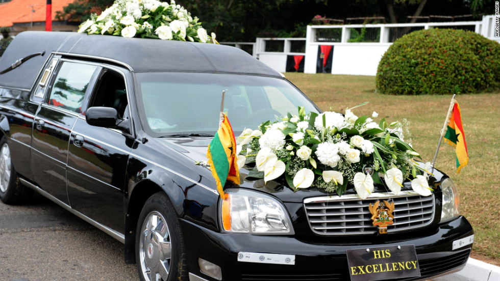 A hearse carries the body of Mills Wednesday to Accra's parliament. The late president was a former law professor and a tax expert. He was Ghana's vice president from 1997 to 2000.