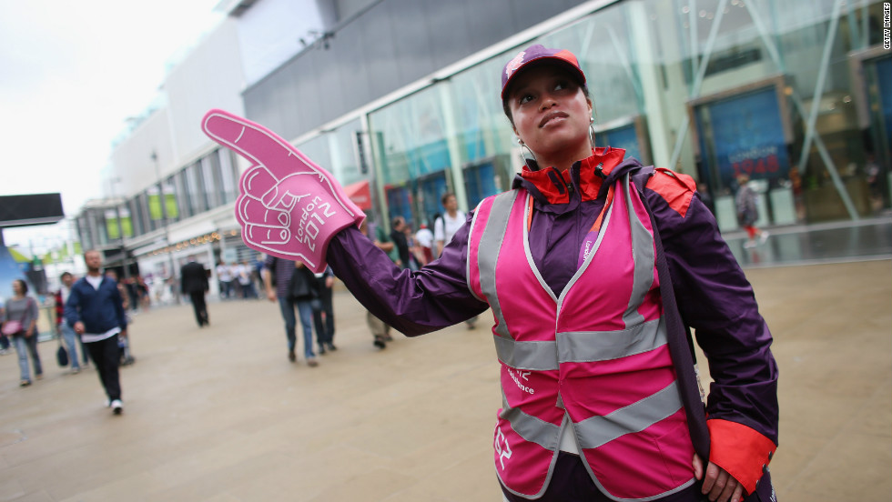 An army of volunteers clad in bright purple, red and pink welcome visitors to the Games.