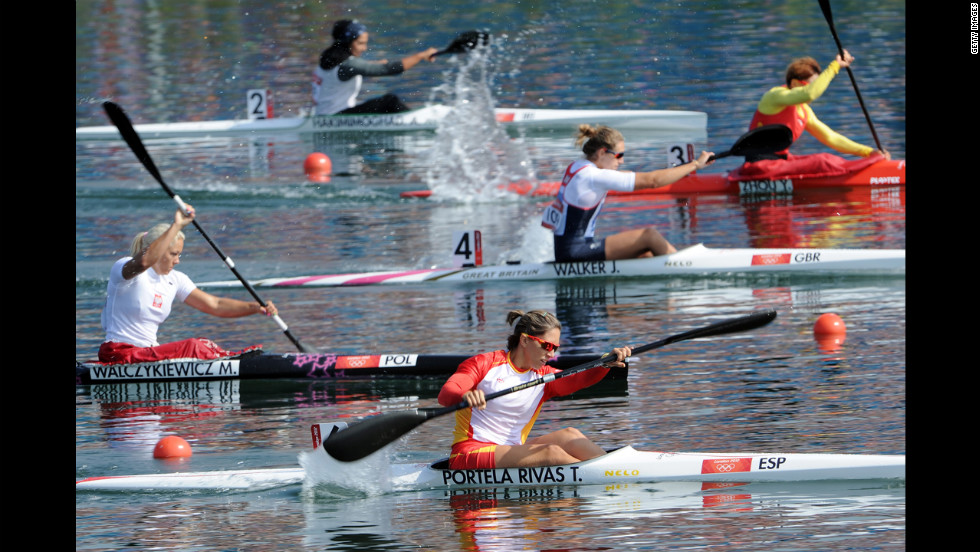 Competitors race in the women's kayak single 200-meter sprint heats at Eton Dorney in Windsor, England.