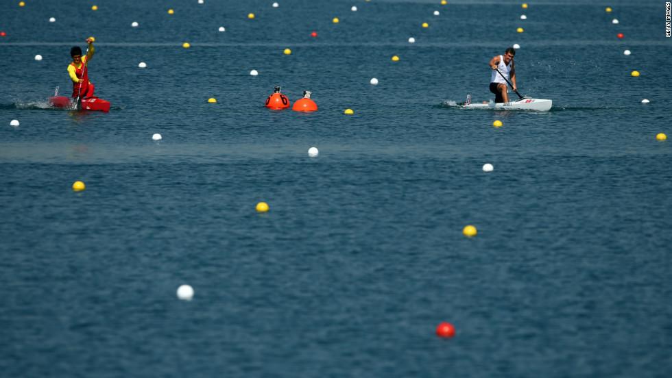 Germany's Sebastian Brendel, right, and Qiang Li of China compete in the men's canoe single 200-meter sprint semifinals.