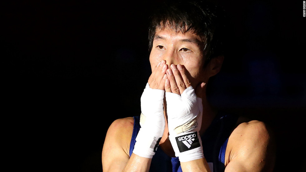 Soonchul Han of Korea reacts after he was declared the winner against Evaldas Petrauskas of Lithuania during their men's light (60 kilogram) boxing semifinal bout.