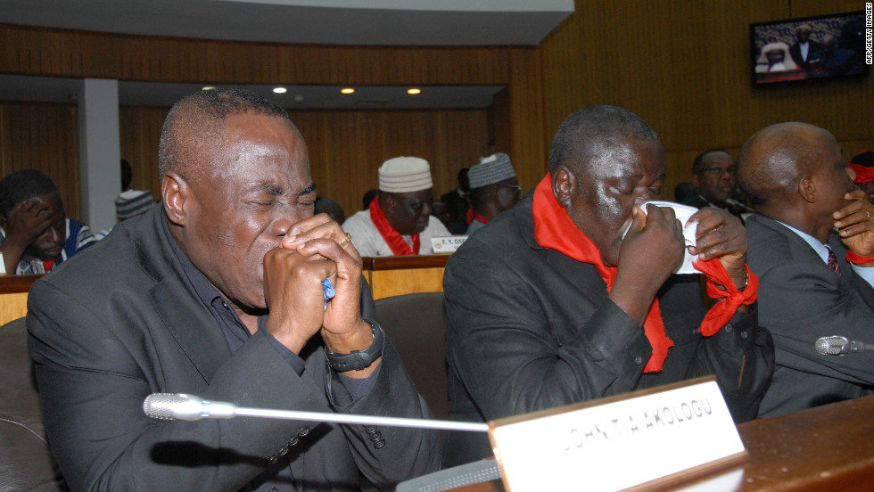 Members of Ghana's parliament weep on hearing the news of Mills' sudden death on July 24.