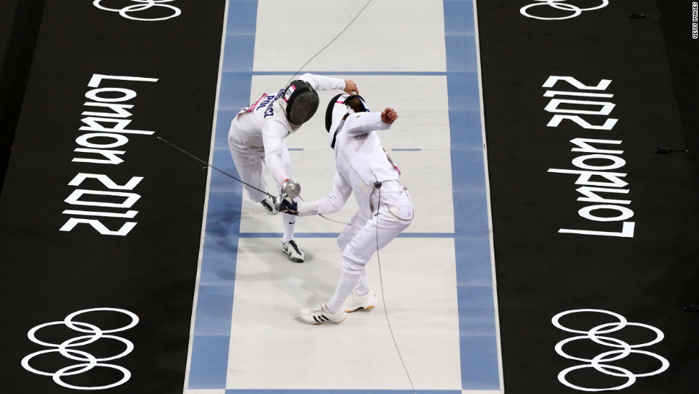 Lithuania's Justinas Kinderis, front, competes against Poland's Szymon Staskiewicz in a fencing bout during the men's modern pentathlon at the London 2012 Olympic Games.