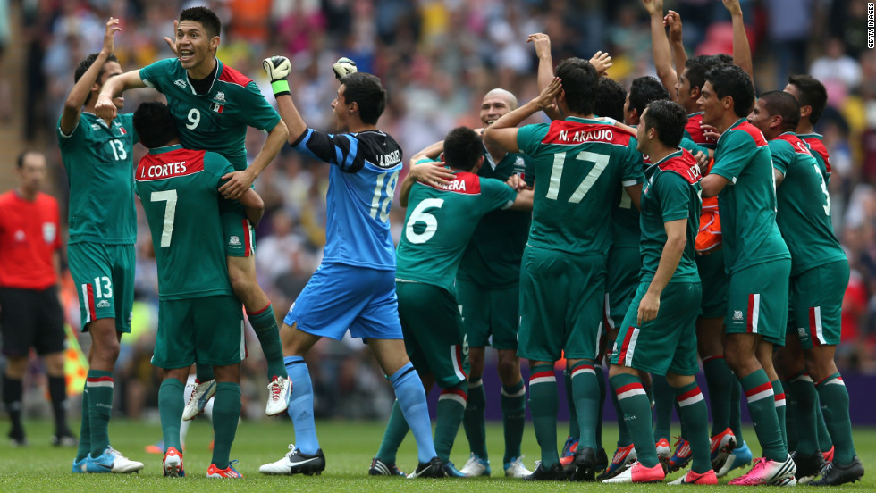 No. 9 Oribe Peralta, who scored both of Mexico's goals, celebrates with his team after defeating Brazil 2-1 in the men's football final.