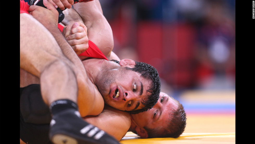 Turkey's Ibrahim Bolukbasi, left, wrestles the United States' Jake Herbert in the men's freestyle wrestling match.