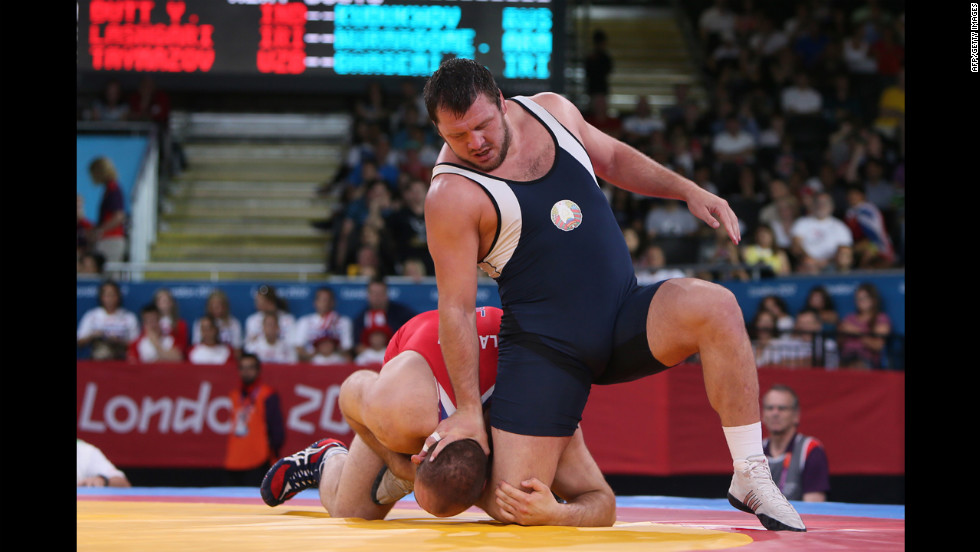 Freestyle wrestling includes butt-kicking, head-banging and -- shown here -- boot-licking.