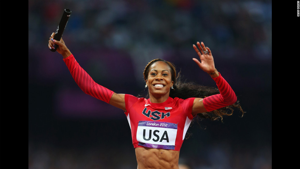 Sanya Richards-Ross of the United States celebrates as she crosses the finish line to win gold in the women's 4x400-meter relay final.