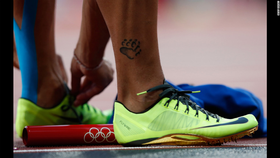Simone Collio of Italy prepares to compete in the men's 4 x 100-meter relay round 1 heats.