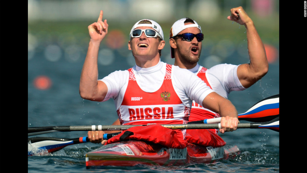 Yury Postrigay and Alexander Dyachenko of Russia celebrate winning the gold medal in the men's kayak double 200-meter canoe sprint final.