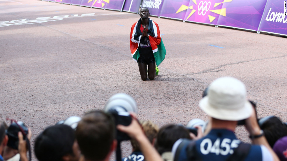 Abel Kirui of Kenya gives thanks after winning the silver medal in the men's marathon at The Mall in London.