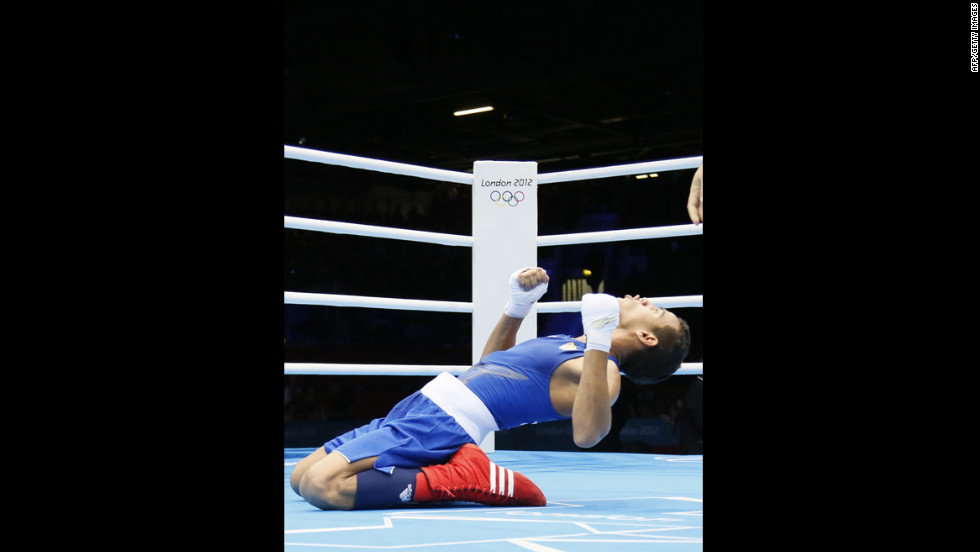 Robeisy Ramirez Carrazana of Cuba celebrates winning the gold medal by defeating Tugstsogt Nyambayar of Mongolia in the men's boxing flyweight 52-kilogram final match.
